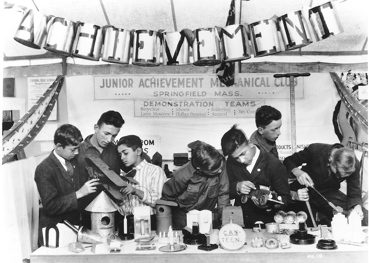 Historical photo of JA mechanical club working on CAN-TEEN project