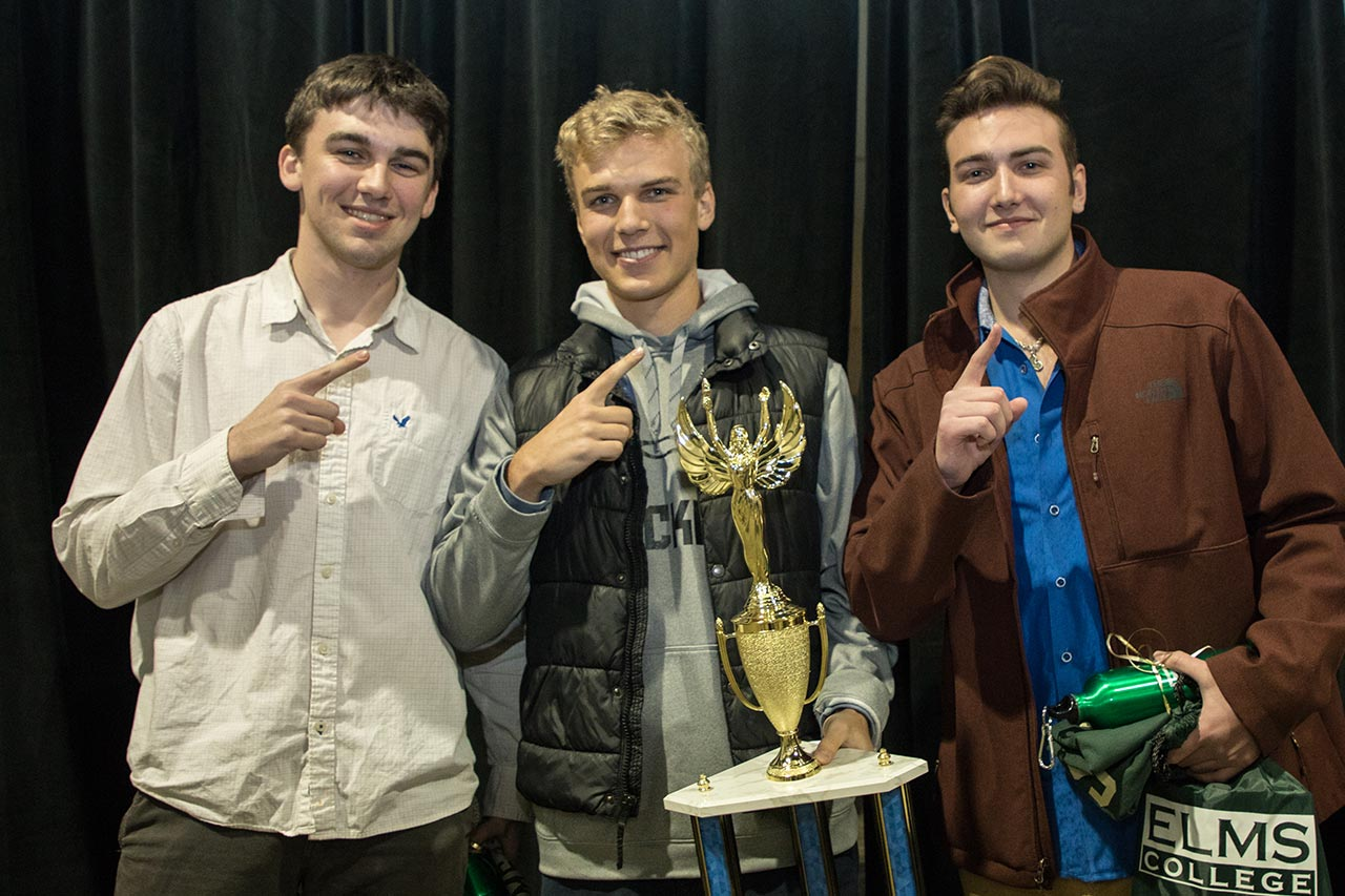 teen boys with first place trophy