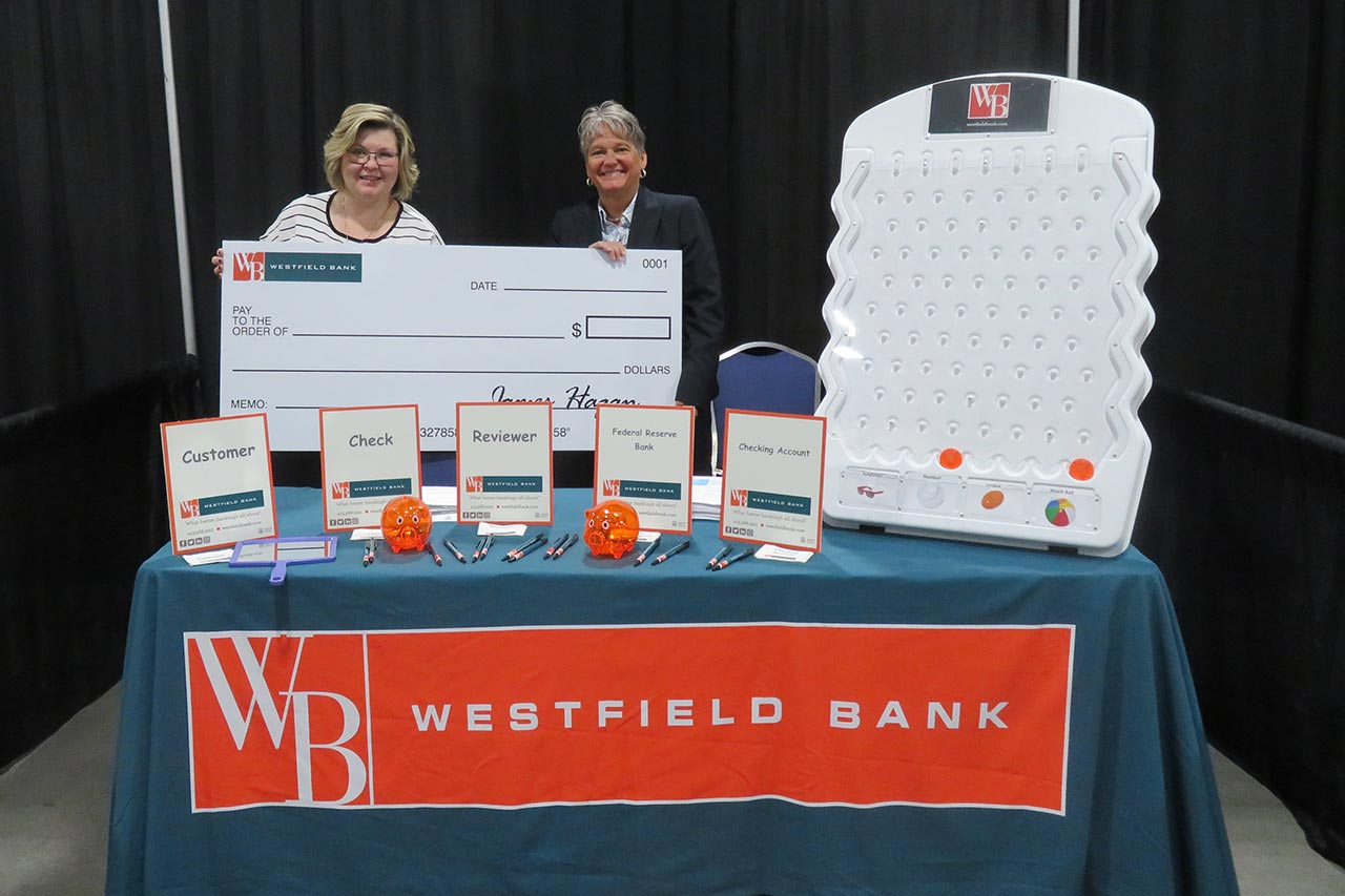 bank booth with big check