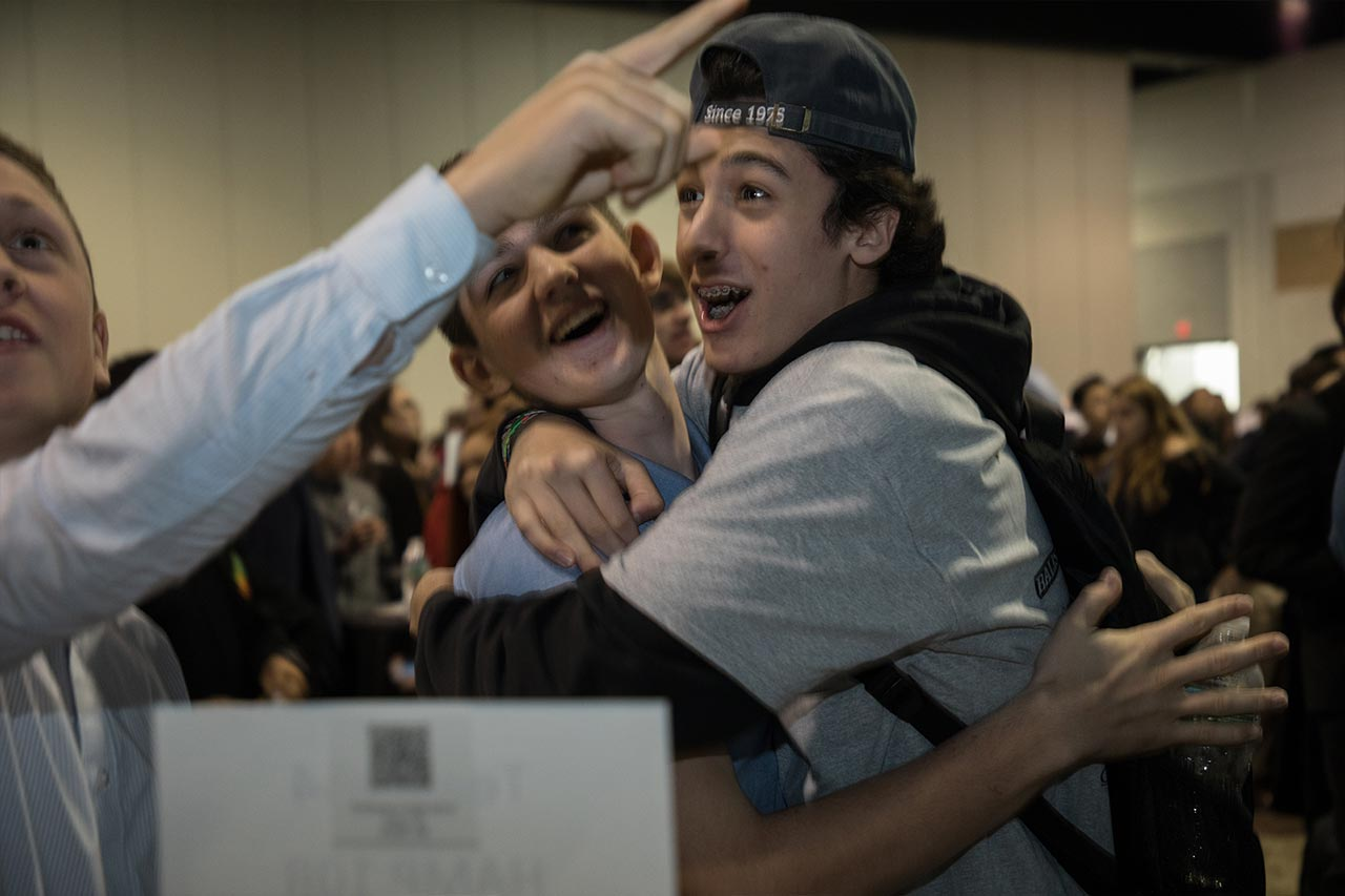 young men hug in excitement