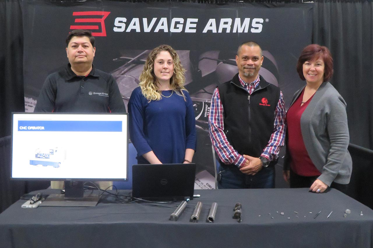 Savage Arms representatives and display booth